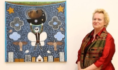 Angelika Tyrone with Trevor Nickolls's painting Metamorphosis, at the College of Fine Arts, UNSW, Sydney. Picture: James Croucher Source: The Australian