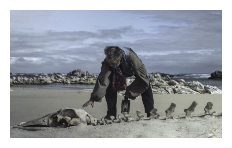 In a still from Mikhael Subotzky's film, WYE, British colonialist James T. Lethbridge, played by John Nankin, comes across a whale skeleton on South Africa's shores. Commissioned by Sherman Contemporary Art Foundation, Sydney.
