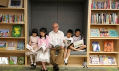 John Vallance, the NSW State Librarian, with the Wu siblings, Ethan, Nathan, Macayla and Allyson, in the new Children's Library. CREDIT: JAMES ALCOCK